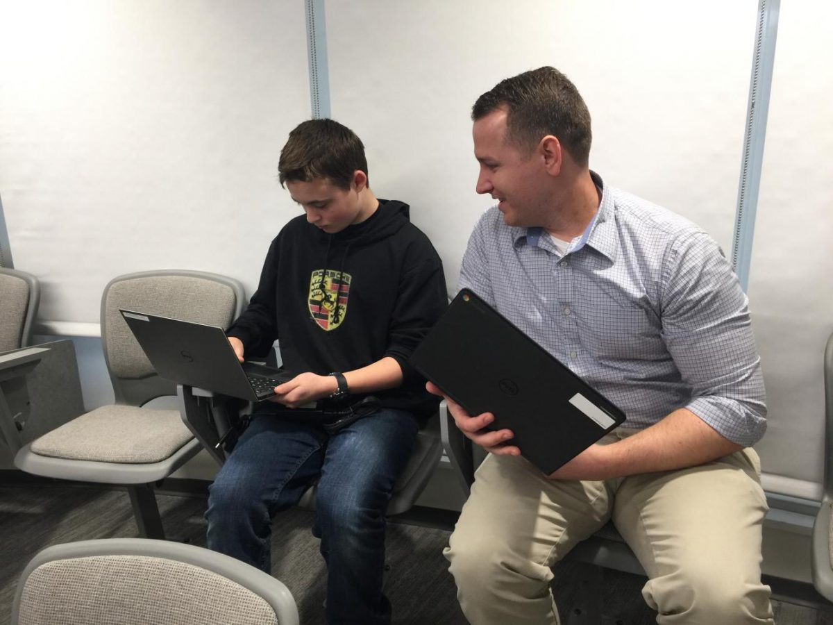 Techie John Castellano introduces a student to the inner trappings of his laptop.