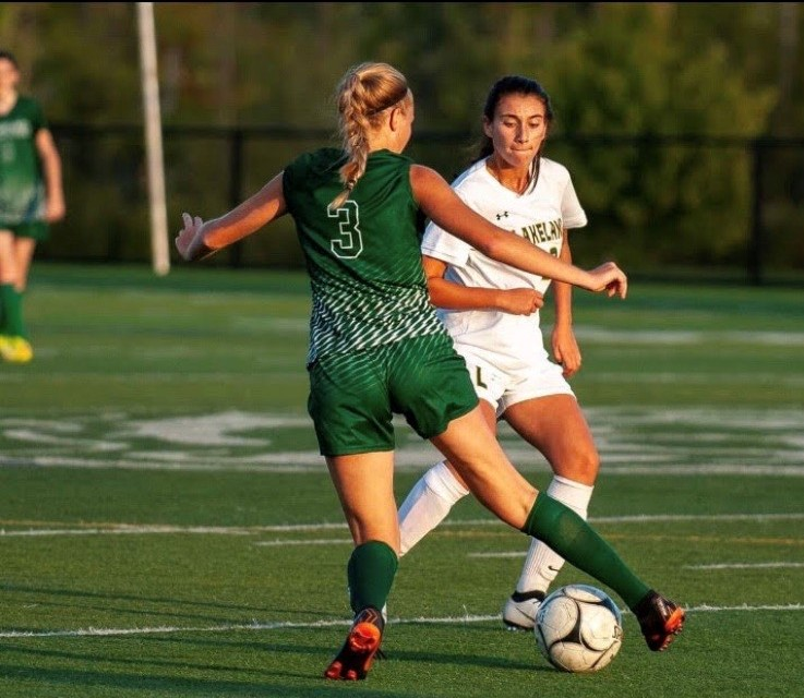 Soccer player Gabriela Jakobsen (3) outmaneuvers a rival for control of the ball during her last playing season.