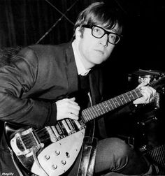 Not+only+in+music%2C+Buddy+Holly+is+an+influence+in+style%2C+as+well.++Below%2C+a+photo+of+John+Lennon+wearing+Buddy+Holly+style+glasses.+