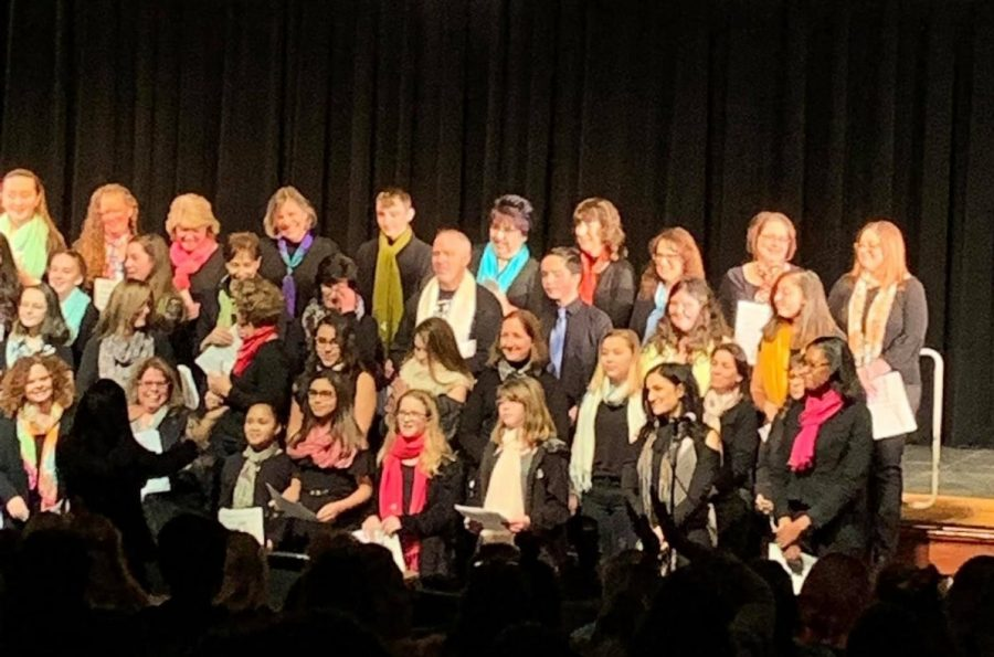 """Join together now: staff and students belt out their rendition of """"We Are the World."""""""