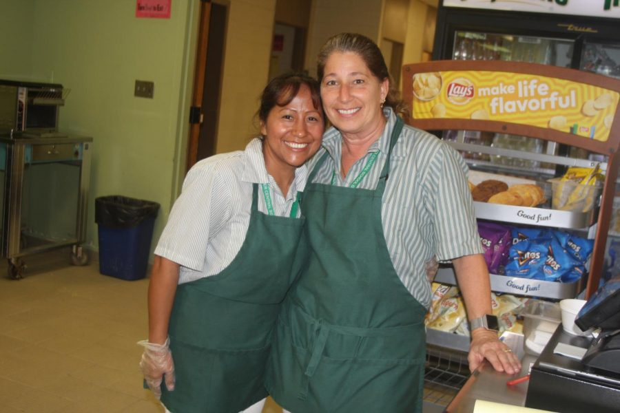 They're more than just a pretty face!  Now you can greet them by name each and every day.  Make sure to thank them for everything they do, as not only do they serve up hot, fresh, nutritious meals, but they also do it with a smile.  Pictured, Norma and Patricia.